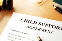 A Child Support document on a table with a pen