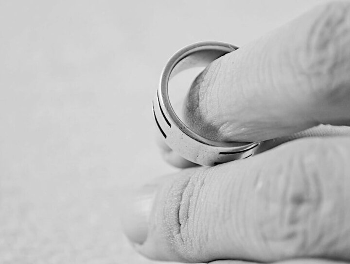 Close up of a hand with a wedding ring